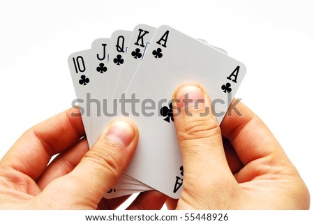 A hand holding five cards in a game of poker isolated