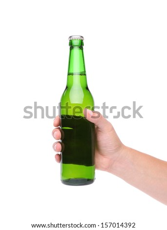 A hand holding up a green beer bottle without label over a white background vertical format