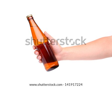 A hand holding up a yellow beer bottle without label over a white background vertical format