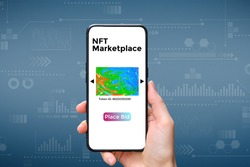 A hand holds a smartphone with an type of cryptographic NFT marketplace art with place bid