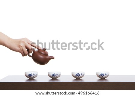 A hand in pouring tea closeup #496166416