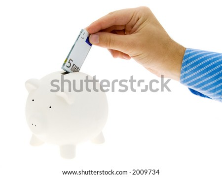 A hand inserting 5 euro in the piggy bank