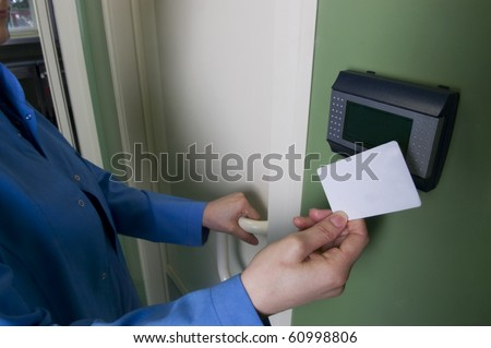 A hand inserting keycard in the electronic lock