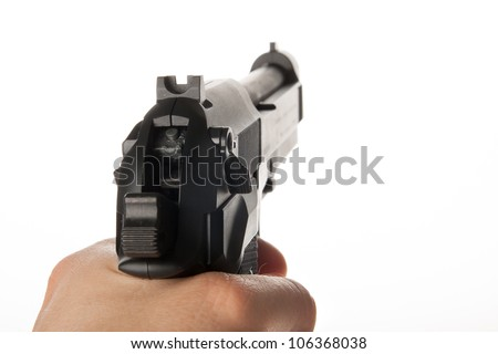 A hand is holding a gun
