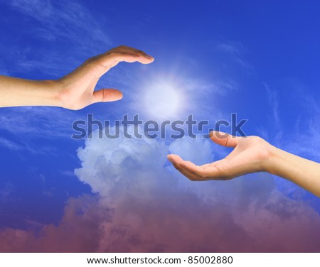 A hand is reaching out in the sky for help