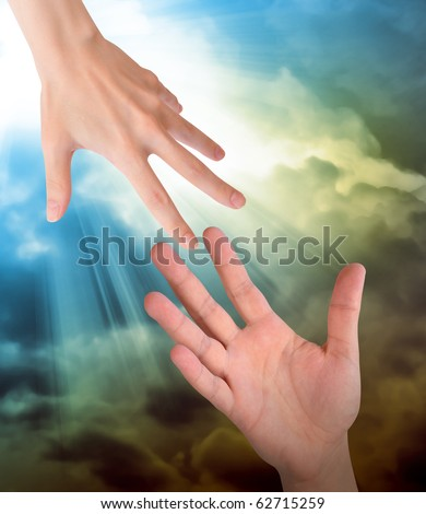 A hand is reaching out or grabbing for help from another hand in the sky. Clouds are in the sky as the background. Use it for a safety, religious or support concept.