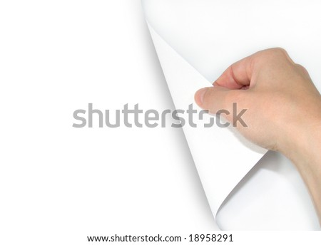 A hand is turning a page over. The page is white and blank so you can add your text.