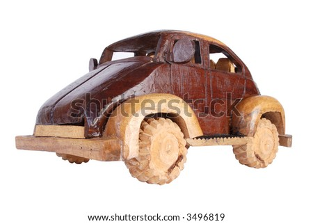 A hand made wooden model of a car