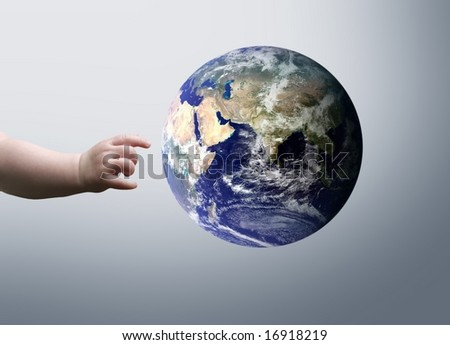 a hand of a child and a globe