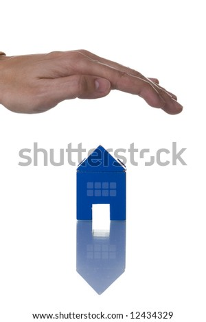 a hand over a house, conceptual protection (isolated on white with reflection)