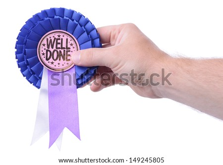 a hand presenting a well done badge isolated on white