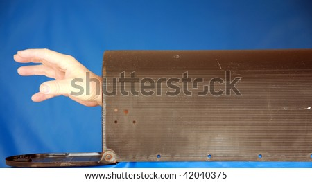 a hand reaches out from inside a mail box