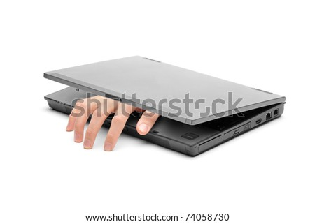 A hand reaching out of a laptop isolated on white background