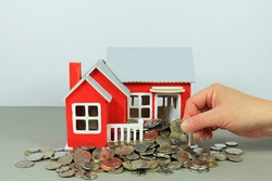 A Hand Selecting A Coin. Releasing Equity In Your Home Concept.