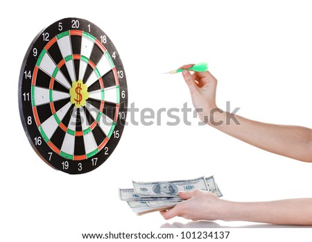 A hand throwing a dart at a sticker on darts on white background