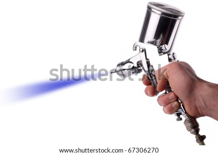 A hand with a spray gun at work.