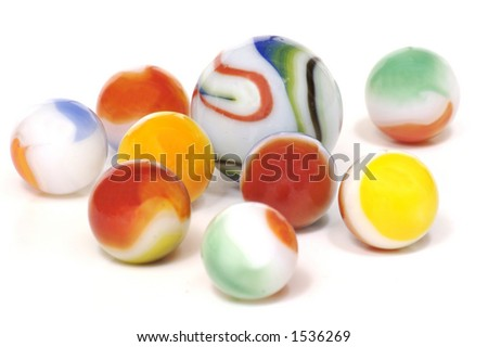 A handful of colorful milky glass toy marbles isolated on a white background