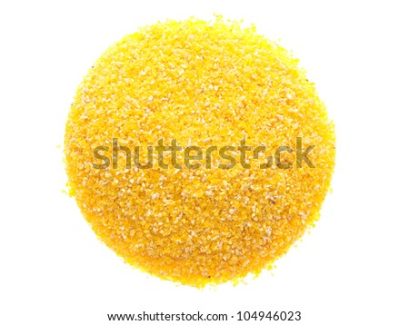 A handful of corn meal. On a white background.