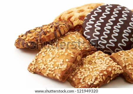 A handful of different cookies on white background