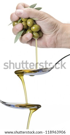 A handful of olives dropping olive oil into a spoon