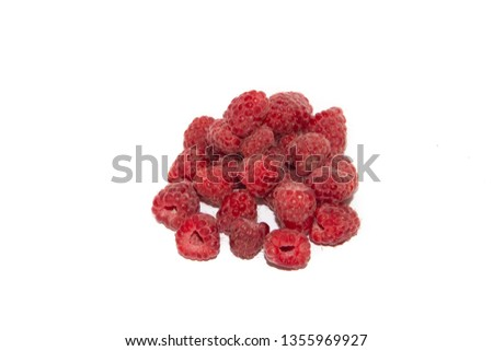 A handful of raspberries isolated on a white background. Red berries. Sweet berries. Forest berries #1355969927