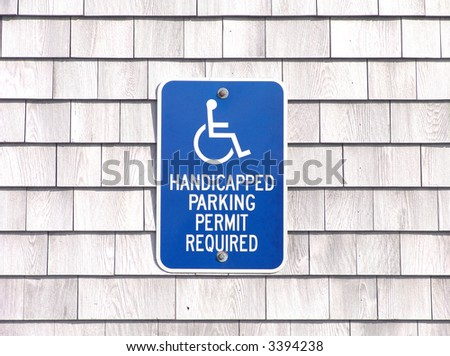 A handicapped parking permit required sign for parking - stock photo