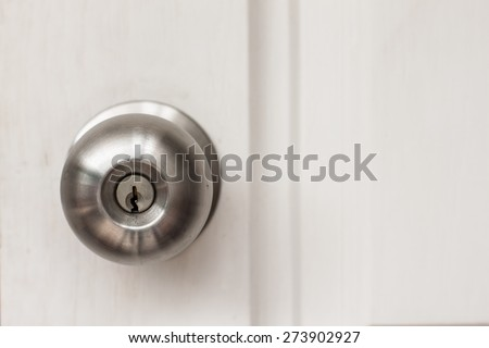a handle on a door that is turned to release the latch