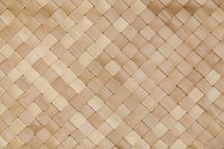 A handmade mat made from palm leaf