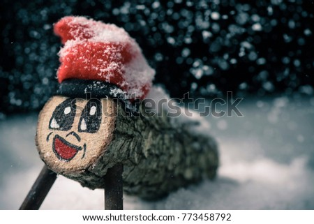 a handmade tio de nadal, a typical christmas character of catalonia, spain, on the snow Zdjęcia stock ©