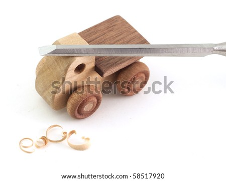 A handmade wooden truck with chisel and shavings