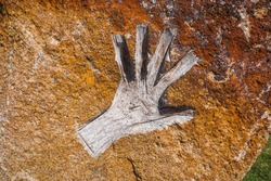 A handprint on an ancient stone. Retro-style.