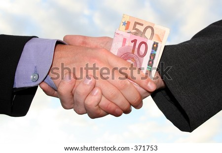 a handshake with money