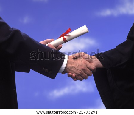 a handshake with presentation of a diploma