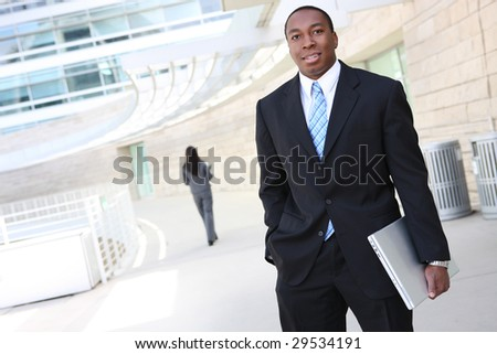 A handsome african american business man with laptop computer