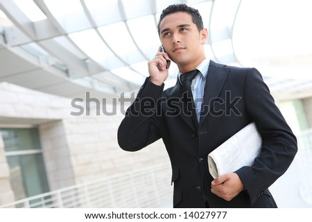 A handsome business man at his company office building