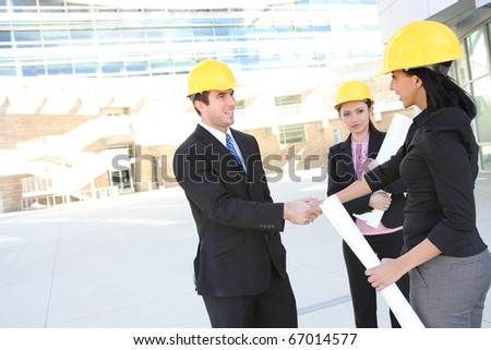 A handsome business man handshake with construction woman at office building