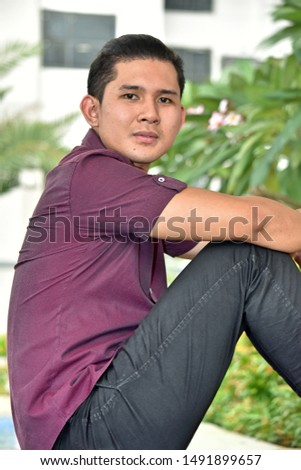 A Handsome Filipino Male Sitting