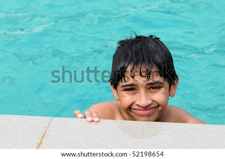 A handsome Indian kid playing in the pool