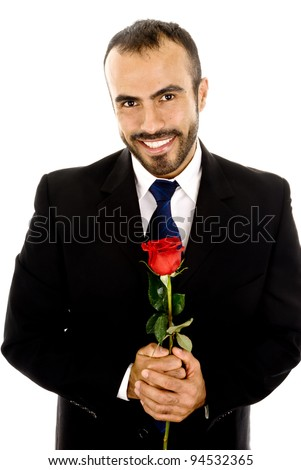 A handsome latin man holding a  rose - stock photo