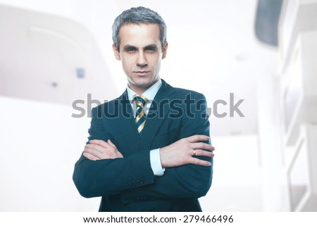 A handsome man in a jacket and tie for business negotiations. Looking at the camera. Office worker. Business decisions. Beautiful light background