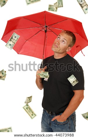 A handsome man looks in disbelief at money falling from the sky
