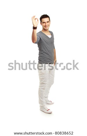 A handsome man shows a sign okay isolated on white background