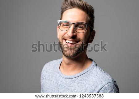 A Handsome man standing over dark grey background Portrait man concept.