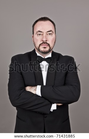 A handsome man with a beard in a black suit