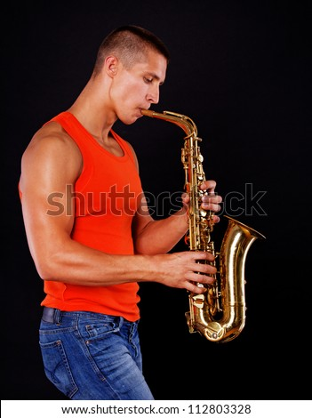 A handsome musician is playing saxophone