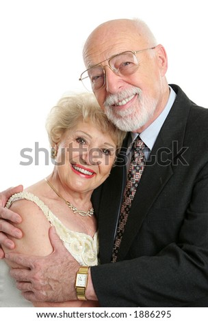 A handsome, successful senior couple dressed up for a special occasion.