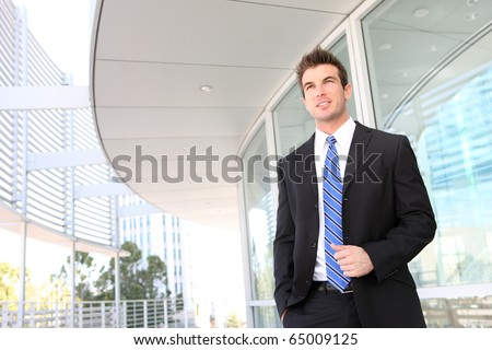 A handsome young business man at office building