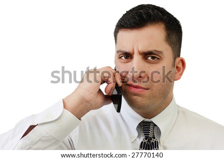 A handsome young businessman confused while talking on a cell phone over white
