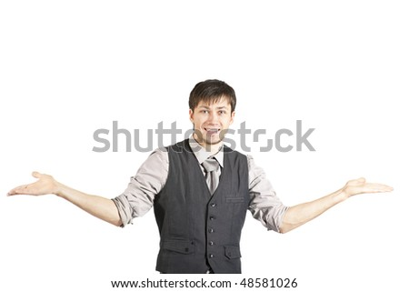 A handsome young businessman in a vest and rolled up sleeves smiles at the camera and shrugs his shoulders. Horizontal shot. Isolated on white.