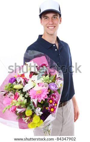 A handsome young man delivering flowers isolated over white